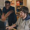 Two EDA Solutions engineers working together at a compute monitor